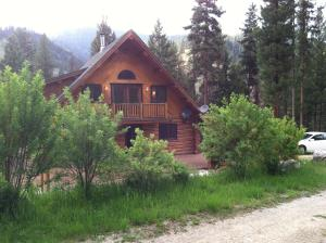 Welcome to Your Log Home, Nestled into the scape of mother nature, much of which is natural landscape.