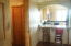 view from dining room into kitchen