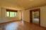 Wide plank pine floors; door to screened porch.