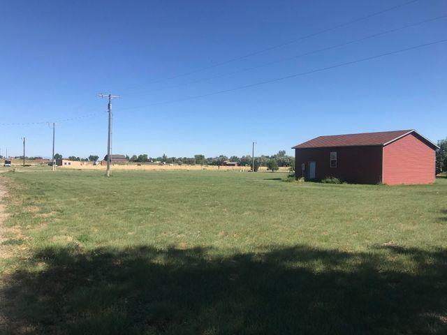 20 minutes from Great Falls, one acre parcel with 28' by 36' shop, built in 2002! Electric already set up, ready to hook into Vaughn water and sewer.