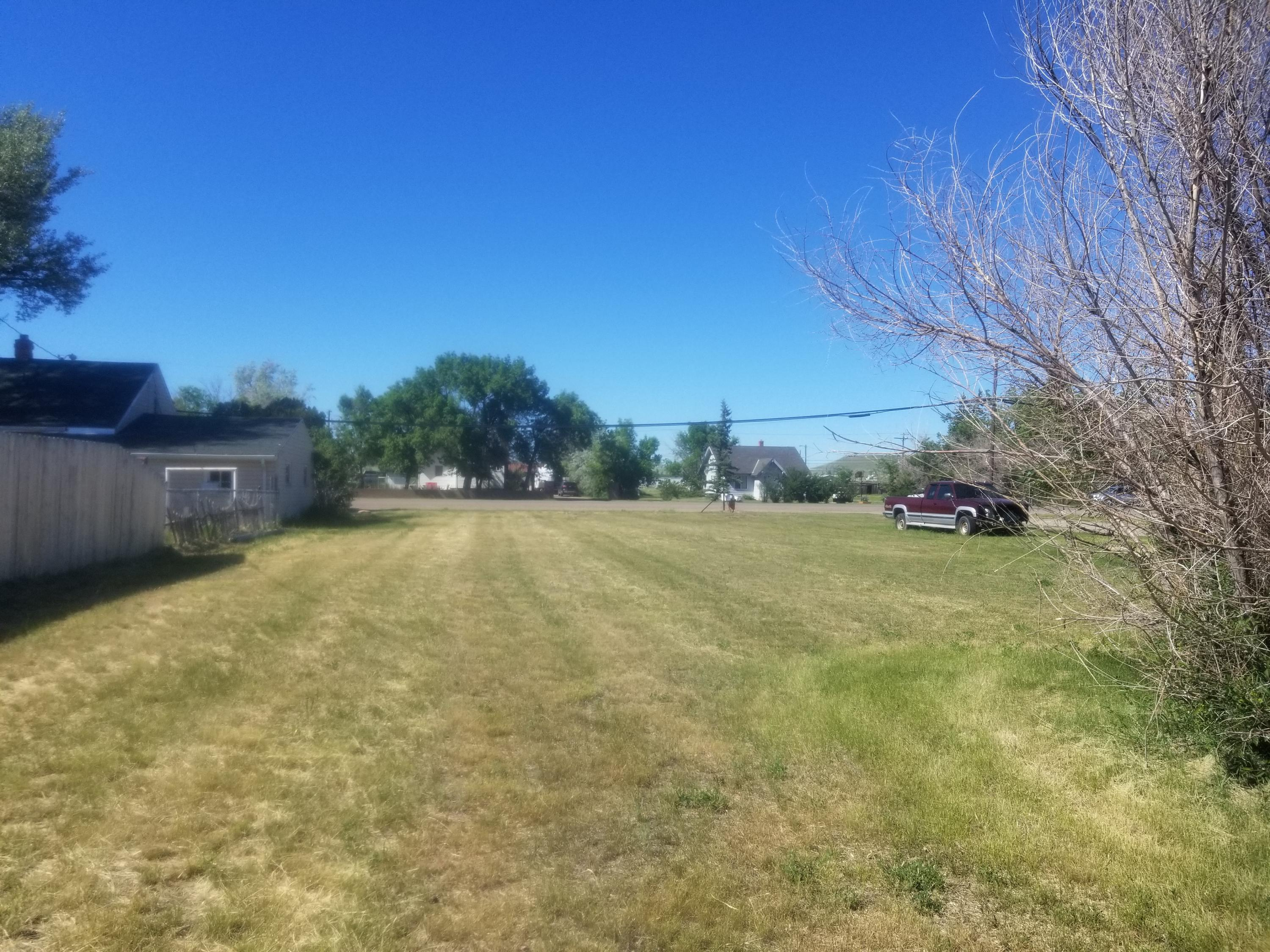 City amenities, but country feel! Great FLAT building site! Build your home on this nice property.  Are you looking to place a manufactured home on permanent foundation with a Detached garage/shop? Electricity, Gas, Water and Sewer are to edge of property. Bring your chickens and/or goats. Call Debbie Dodd at 406-788-1886 or your Real Estate Professional.