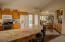 Beautiful granite countertops provide a bar area for quick meals.