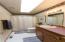 Main floor guest bath boasts a tub/shower combination plus a wonderful skylight.
