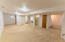 This space is yearning for a pool table and wet bar!