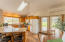 Spacious kitchen with direct access to the deck for BBQs.
