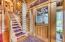 Elegant entryway with etched glass door.