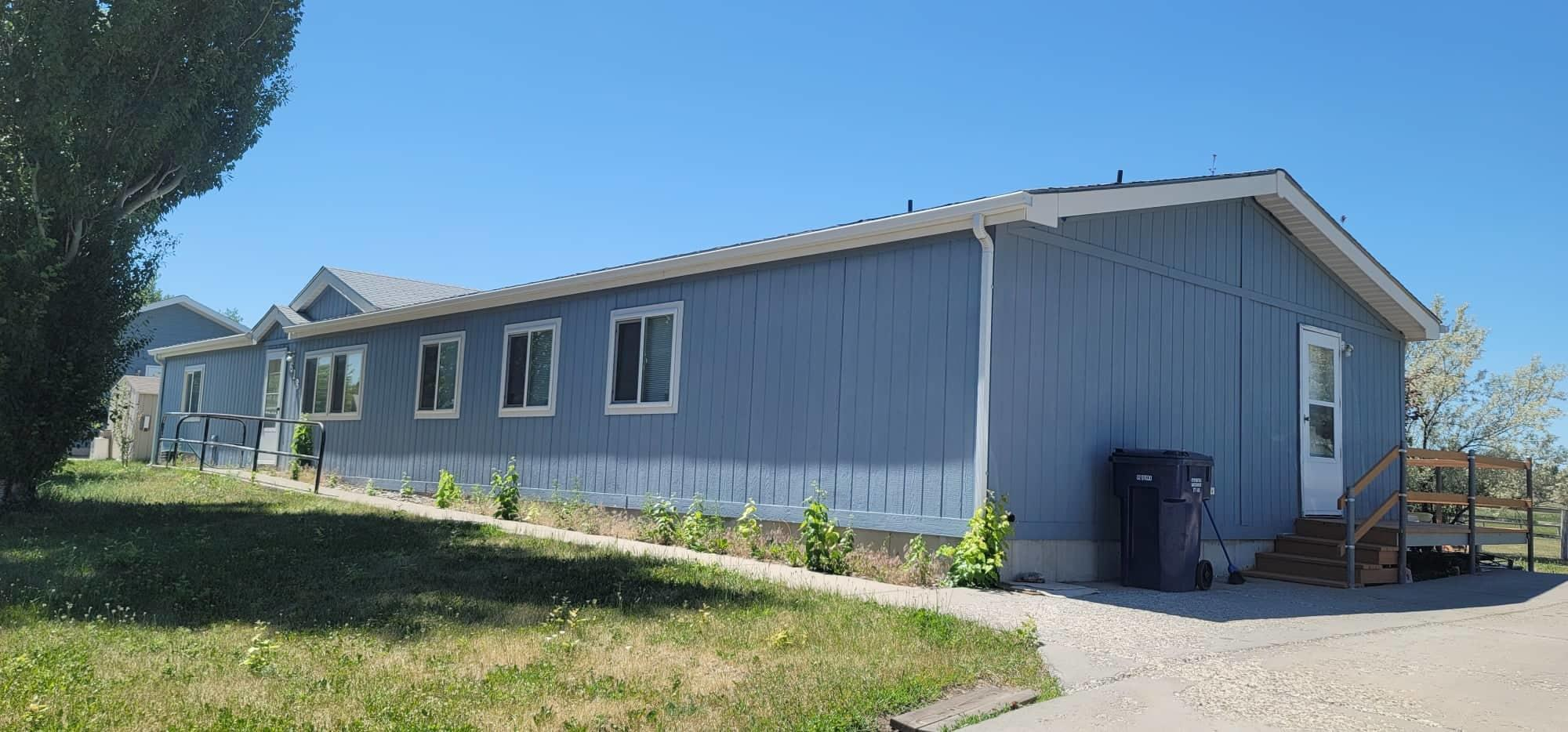 Bring this beautiful ONE LEVEL home back to its shine!  East end home close to Malmstrom Air Force Base. 1993 manufactured home on permanent foundation. Imagine enjoying Montana sunsets from your back deck. Spacious 4 bedrooms/ 2 Bath with separate living room and family room. Den could be used as office or a toy room. Need some TLC but has great potential.Property sells in ''AS IS'' condition. Listed by Dori Johnson.