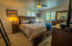 Unwind in the main floor master suite after a hectic day.