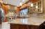 Custom cabinetry, granite counter tops, open concept with peninsula bar