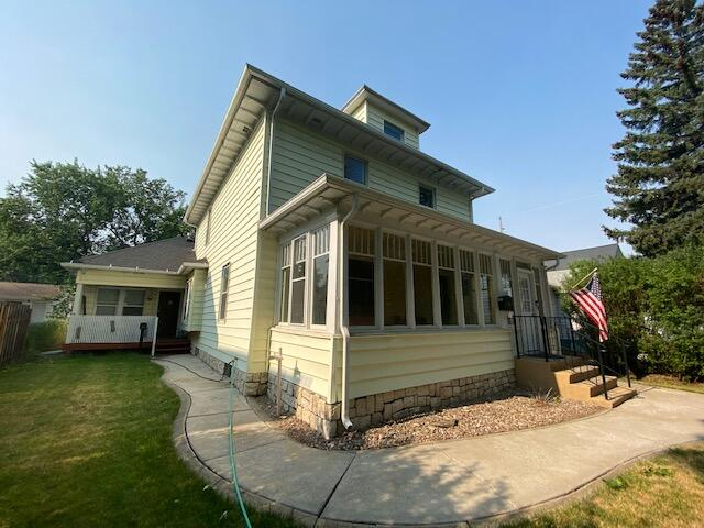 Don't let this beautiful 4Bedroom 2Bath, Victorian home pass! Showcasing Glass doorknobs, Crystal Chandeliers, Crown Molding, hidden doors, stained-glass, and restored 100year old wood floors. Unwind in the upstairs whirlpool or period shower! Relax confidently in all seasons with a new Furnace and Central AC (2019). Laundry hookups are on the main floor bathroom or spacious basement area. Enjoy entertaining guests on the enclosed front porch. Take advantage of the 1bed-1bath Guest House for an extended stay guest or passive income in this rental hungry city ($$$)! Both with independent climate controls, water heaters, and utilities; making renting a breeze! The back yard is enclosed and has a large parking area for everything that doesn't fit in the detached two-car garage.