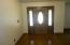 Entry foyer w/oak flooring.