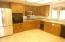 Kitchen w/Corian countertops.