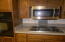 Wall oven, countertop range, and microwave.