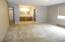 Master bedroom w/walk-in closet, vanity area, bath-toilet entry.