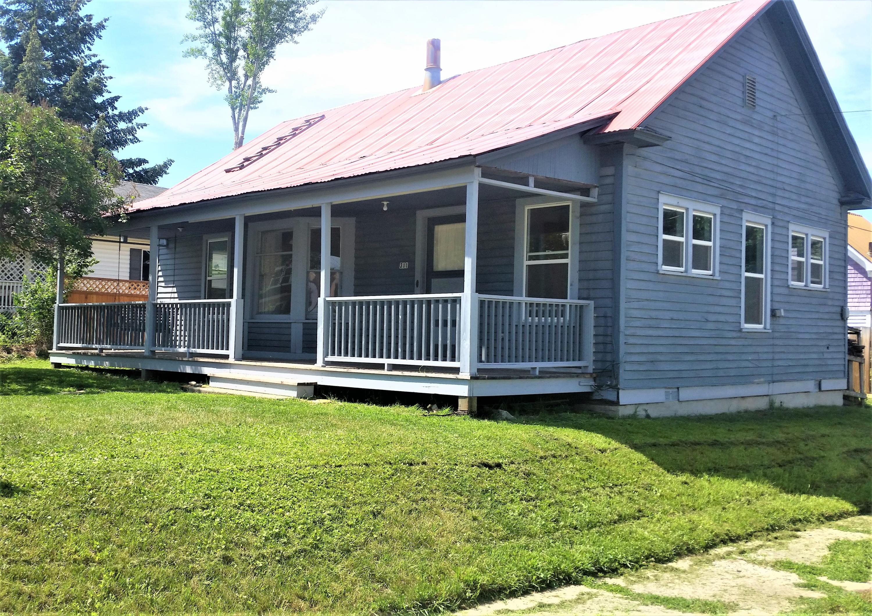 Downtown charmer convenient to area shops, schools, and recreation. This home would make a great starter home or rental property. Stylishly renovated, this single level home boasts 3 bedrooms and an open floor plan rich in natural light. Hardwood floors and a wood stove compliment this budget friendly home in town.  Situated on a large corner lot with mountain views you will adore the location. Contact Gretchen Lancaster at 406-291-7099 or your real estate professional.