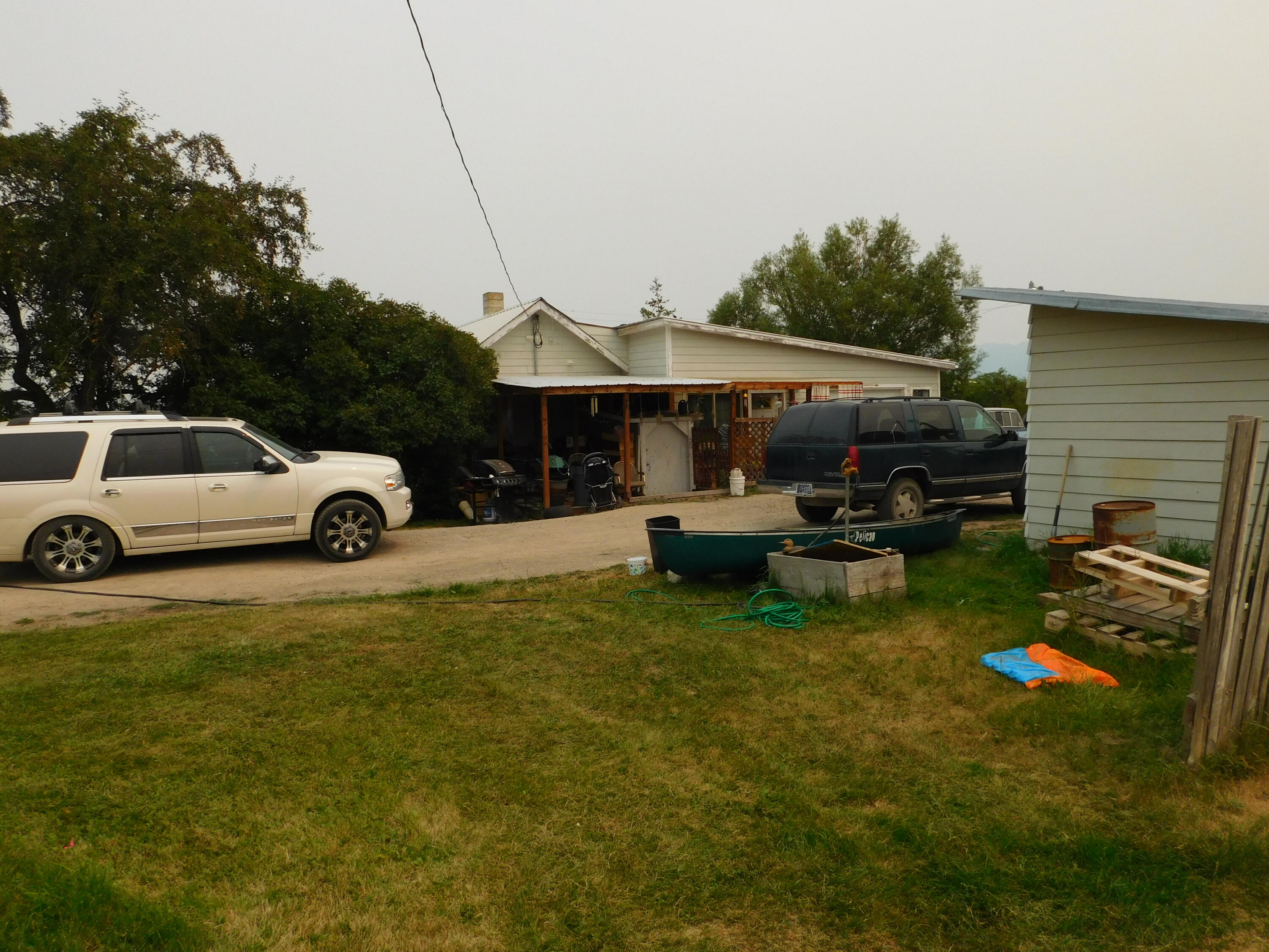 Good for first time owner or as income property.  Tenants in place on a month-to-month basis. Corner lot with good mountain views.  City water & sewer.  Mobile and land on rear of the lot is for sale also.