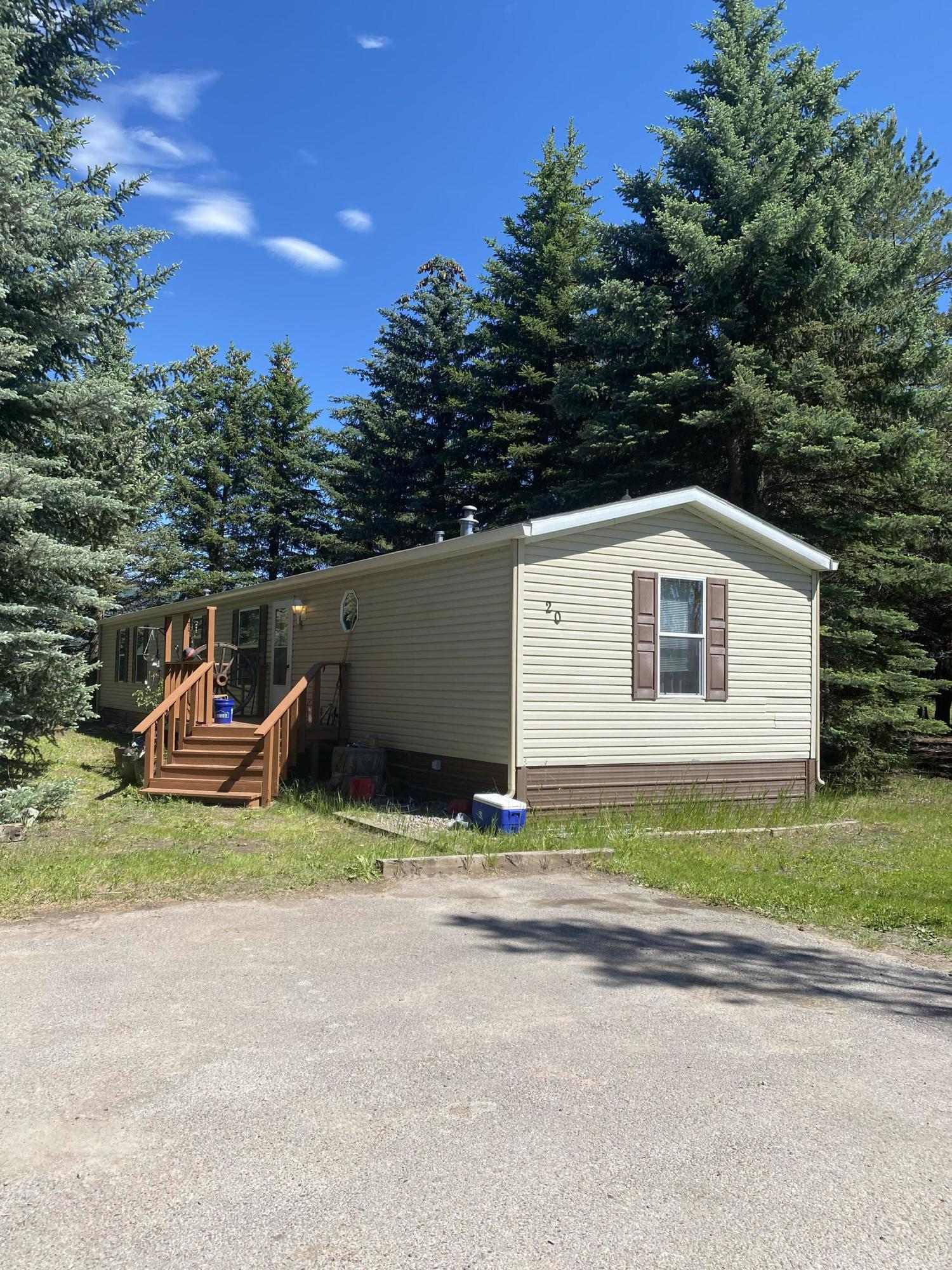 BACK ON THE MARKET_ NO FAULT OF THE PROPERTY!!PRIVACY IN A MOBILE HOME PARK!!! Yes!!---Come check out this charming 3 bed/2 bath mobile home in a quiet country setting! Home has many upgrades such as central air conditioning, Bamboo flooring, as well as 2 decks and a fenced in dog area. The back deck also has a built in kayak/ canoe storage shelf. Home sits in a mobile home park and any potential buyer not moving the mobile home will need to get approval from manager to continue renting the lot. SALE IS OF TRAILER ONLY AND DOES NOT INCLUDE ANY REAL PROPERTY. For a showing please call Billy Carpenter at (406) 253-1894 or your real estate professional.