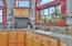 Maple Cabinetry + Polished Concrete Countertops + tile backsplash