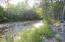Year-round Skalkaho Creek running through your front yard.