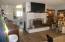 Spacious living room w/fireplace.