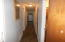 Hallway leading to 3 bedrooms and bathroom.