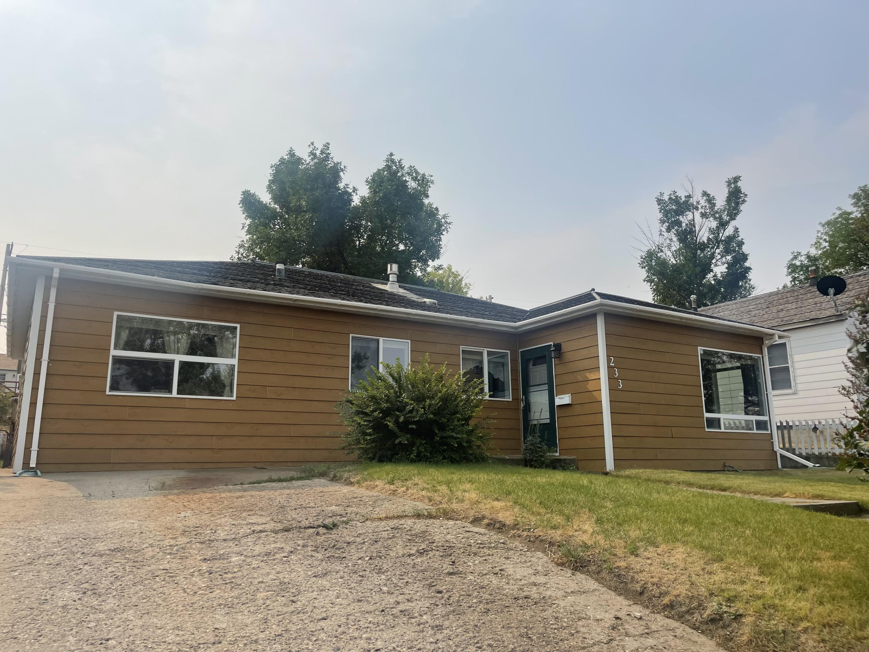 Large home with a 2 car garage. Updated siding, windows, kitchen, large dining area & living room with a gas stove. Main level has 2 beds, full bath, large living room, kitchen, dining and bonus area. Lower level has a family room, 2 non-conforming beds, storage room, updated full bath, laundry/utility room. Fenced in back yard with hot tub and deck. Off street parking. Roof, trim & garage door recently painted. Replacing south facing bedroom window, Replaced internal sewer line in laundry room with pvc. Call Jessica Hedges at 406-845-3156, or your real estate professional.