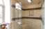 Tiled shower in primary bathroom.