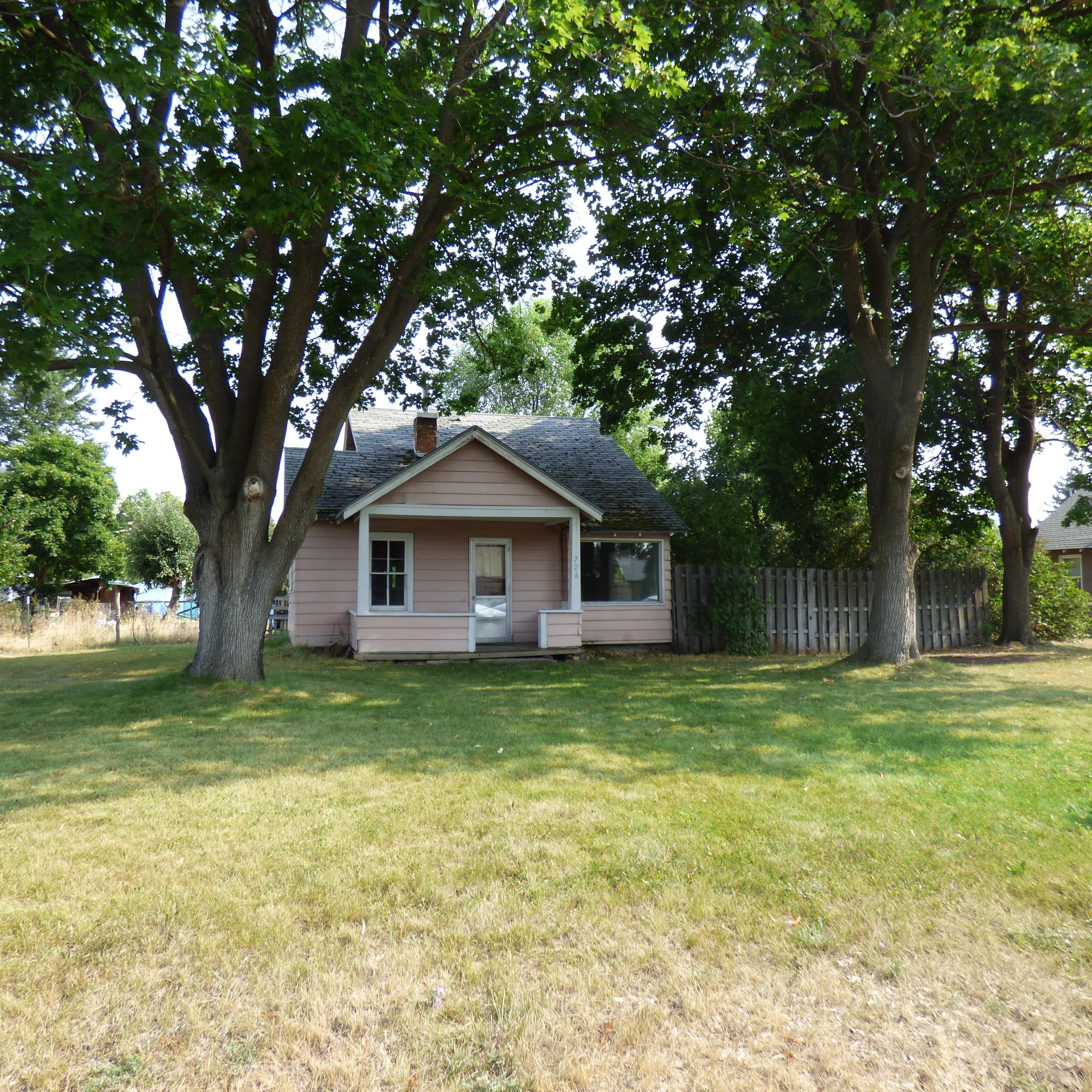 3 Lots (11,717 square feet) in the Slant Streets with RM1-45 Zoning!  There are so many possibilities for development.  House is in poor condition and value is in the land with zoning favorable for development opportunities.  No showings to be arranged, however, there will be an open house on Sunday, June 6 from 1-4.  Please do not approach renters, or enter yard.  Call Lorin/Amy Peterson at (406) 370-4144, or your real estate professional.
