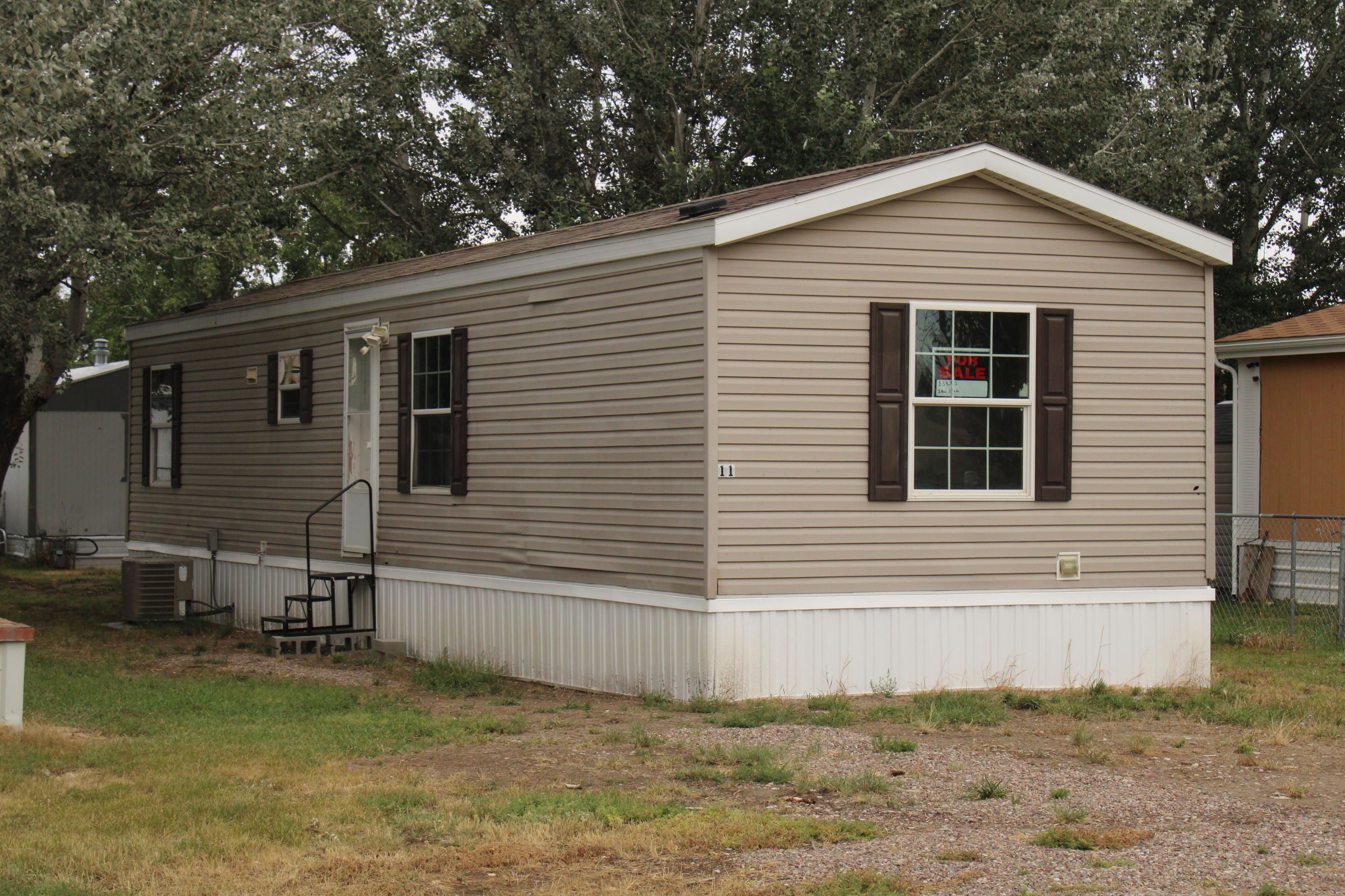 This 2012, 2 bed, 2 bath Mobile home is located in Vaughn only 12 miles from Great Falls. Interstate Highway the whole way! It is located in the Beautiful Red Sky Community mobile home park. Park has been under new management with an onsite manager. Beautiful Rural setting with mature trees.Vaughn has a grocery stores, Restaurant/bars, and the school is within walking distance.Buyer must be accepted unto the park.Home must stay in the park for 24 mos after Closing. Lot Rent is: $395/mo.Fences and 2 non aggressive breed dogs are allowed.No Kitchen Appliances are included.