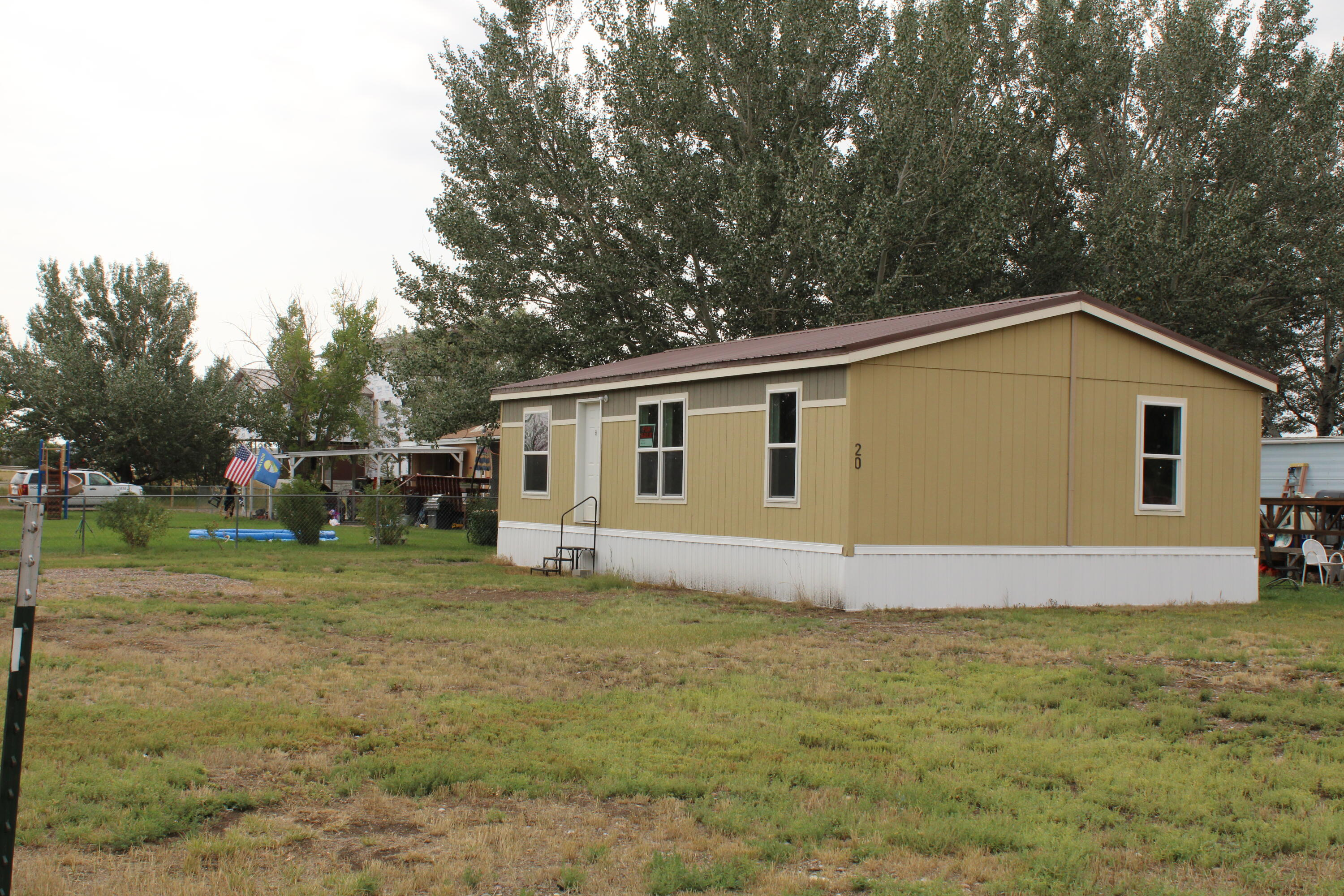 This 2015, Double Wide, 3 bed, 2 bath Mobile home is located on a huge lot in Vaughn, Only 12 miles from Great Falls. Interstate Highway the whole way! It is located in the Beautiful Red Sky Community mobile home park. Park has been under new management with an onsite manager. Beautiful Rural setting with mature trees.Vaughn has a grocery stores, Restaurant/bars, and the school is within walking distance.Buyer must be accepted unto the park.Home must stay in the park for 24 mos after Closing. Lot Rent is: $595/mo.Fences and 2 non aggressive breed dogs are allowed.