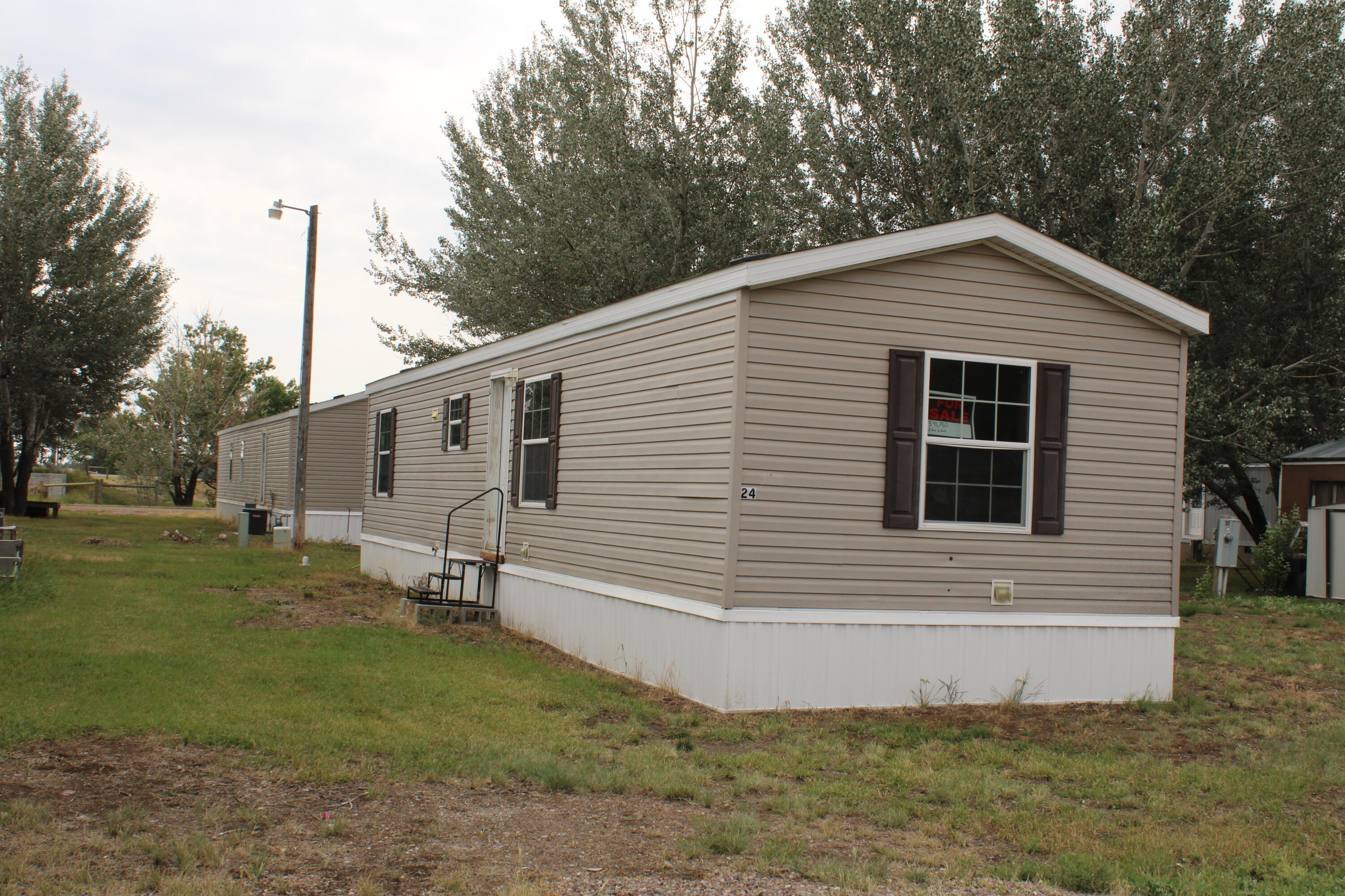 This 2012, 2 bed, 2 bath Mobile home is located in Vaughn only 12 miles from Great Falls. Interstate Highway the whole way! It is located in the Beautiful Red Sky Community mobile home park. Park has been under new management with an onsite manager. Beautiful Rural setting with mature trees.Vaughn has a grocery stores, Restaurant/bars, and the school is within walking distance.Buyer must be accepted unto the park.Home must stay in the park for 24 mos after Closing. Lot Rent is: $390/mo.Fences and 2 non aggressive breed dogs are allowed.