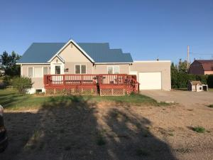 Personality throughout this three bedroom, 1 bath home.  Built in 1930, bedrooms were required to be well-lit and properly ventilated which is evident in this home.  Ease of a central bathroom.  Galley kitchen leaves more room for a dining area for entertaining.  Newer living room carpet and metal roof.  East view captures the sunrise over the Sweetgrass hills.  Small details from the 1930s such as original closet doors add a comfortable touch throughout.  This corner lot has room for a garden or room to play not to mention privacy!   Nestled in a quiet neighborhood, close to schools and city swimming pool & park.  Come introduce yourselves to this home packed with personality!  You won't be disappointed. Call Shawn Christiaens @ 406-450-3805, or your real estate professional.