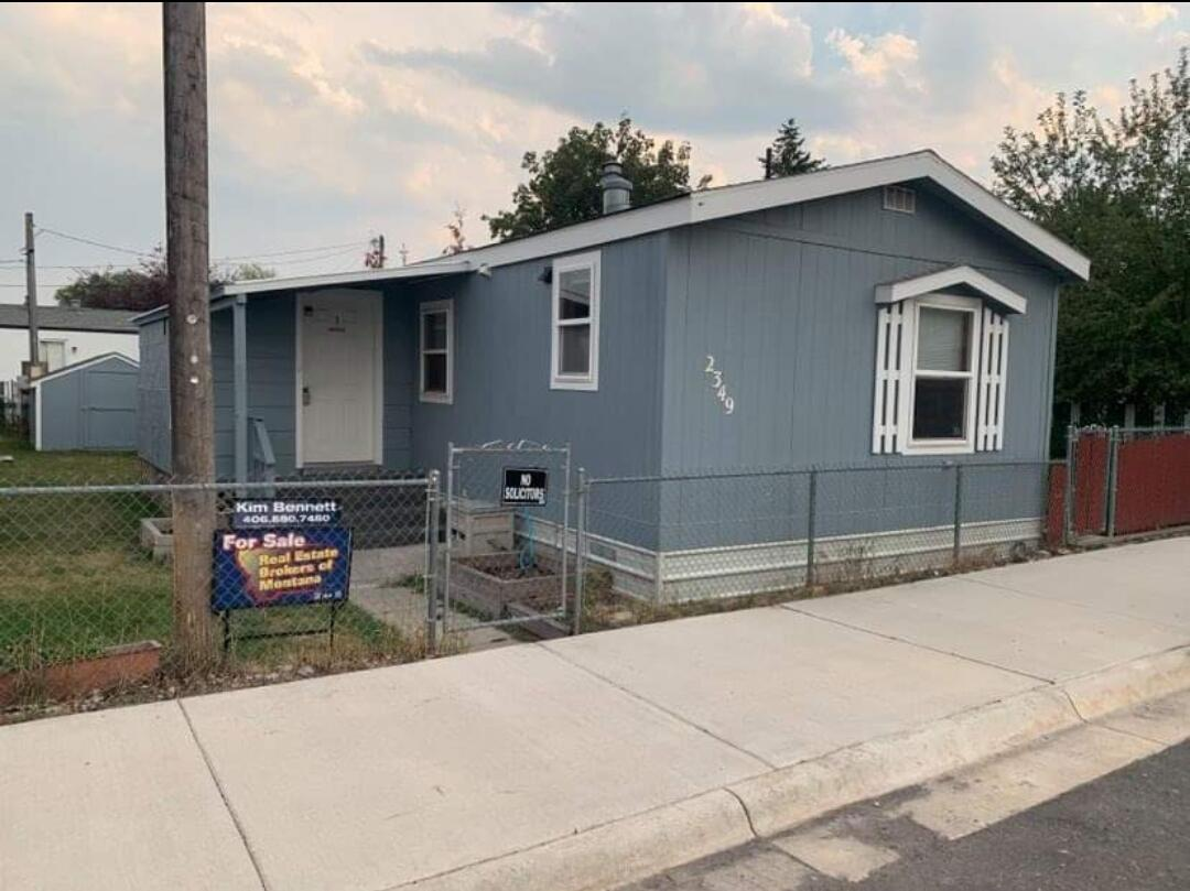 Large 18 X 76 ~ 1996 modular home completely remodeled with tiled shower, upgraded appliances, new paint and carpet throughout.  Front & rear entrances have covered decks with the front being enclosed.  Fully fenced yard with room to garden.  End of the road lot ( lot rent $450 which includes H20, sewer & garbage ). Very private and centrally located for quick access to all services.  Landlord will need to approve new owner .  Lease & application are in documents.  All information deemed reliable but not guaranteed, Buyers and their agents to conduct their own due diligence. Call Kim Bennett @ 406-880-7480, or your  real estate professional.