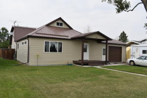 208 S Michigan Front of home with maintenance free deck