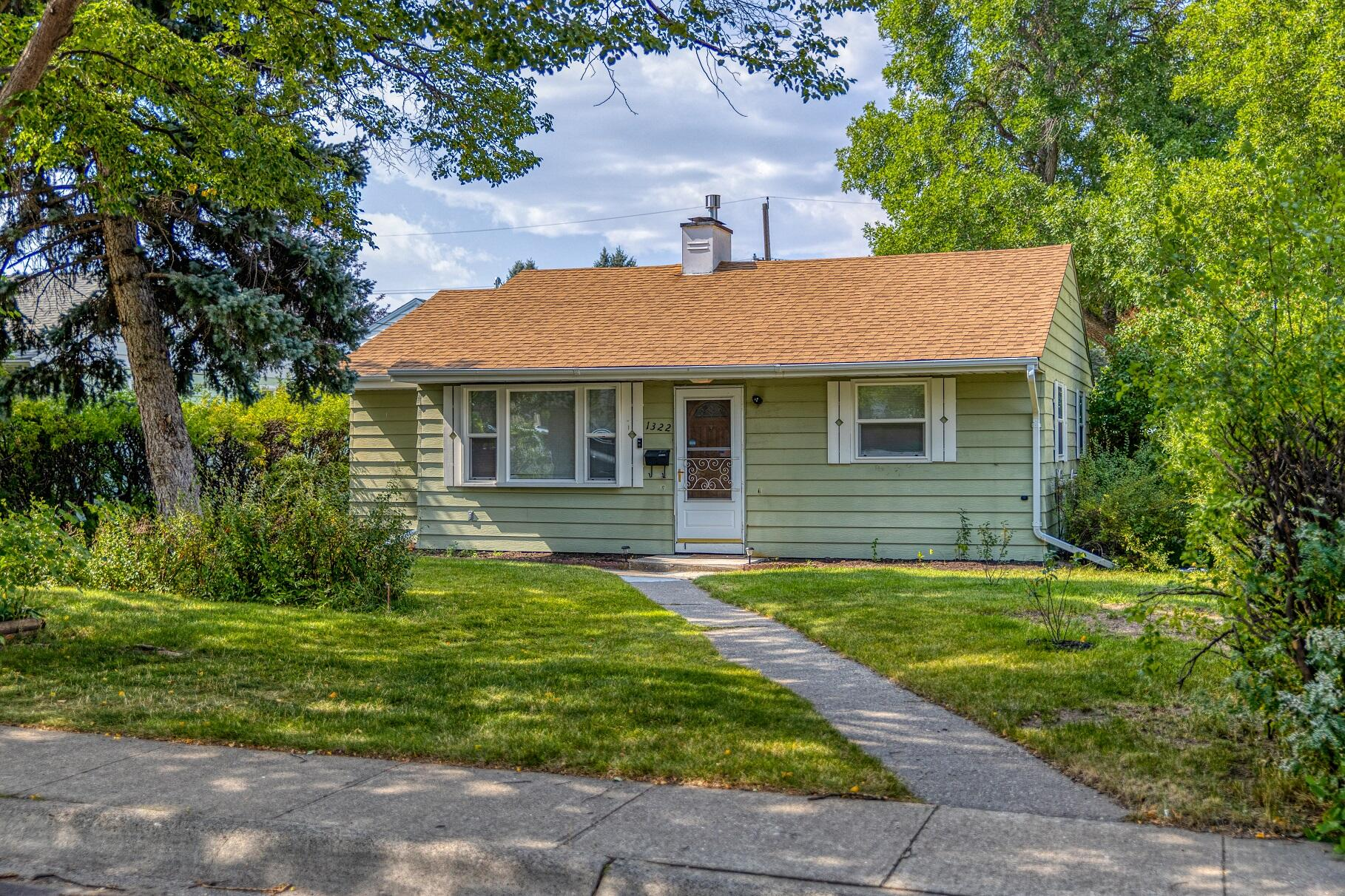 This cozy 2 bedroom home next to Sunnyside Park wont last long! With newer appliances, new texture and paint, newer flooring, newer windows, electrical updated to 200amp in the house and garage and A/C this home is move-in ready. The property features mature landscaping and shade trees. The back yard is fully fenced with a raised garden bed, blueberry bushes, raspberries and RV parking.