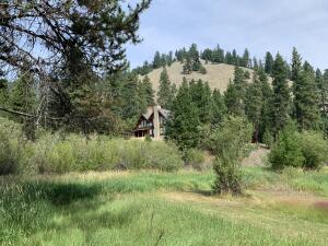 64 acres of fabulous land with luxury log home in Western Montana.