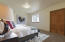 Lower level bedroom 2 (digitally staged).