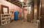 Utility room with abundant storage.