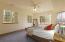 Lower level bedroom 1 (digitally staged).