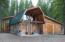 Log home with 2-car attached garage.