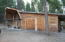 Log home with 2-car attached garage and dog run on the right hand side.