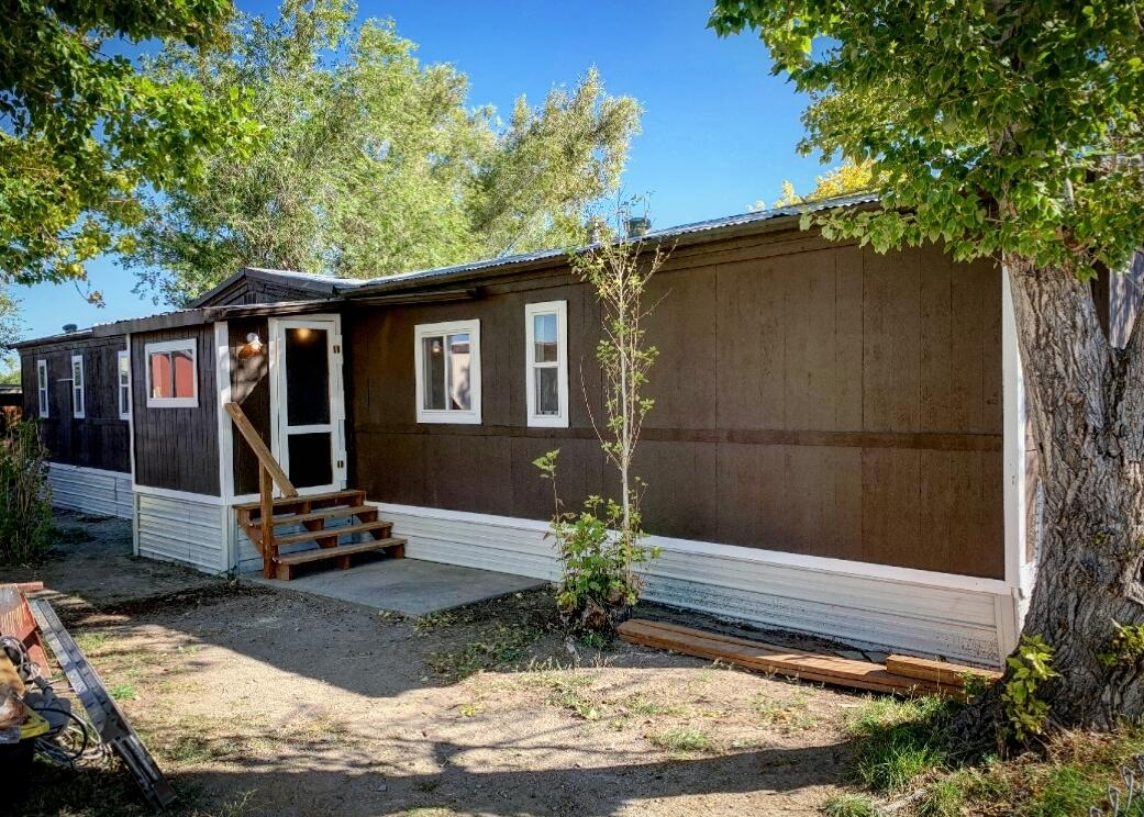 Completely remodeled two bed, two bath trailer in Golden Estates. Property features a fenced yard, covered patio, and storage shed, along with master suite with separate shower and oversized tub. New paint, new flooring, new windows, new water heater. Call Angie Spolar at 406-498-1146, or your real estate professional.Golden Estates lot rent is $350/month.Buyer must have park approval prior to closing.