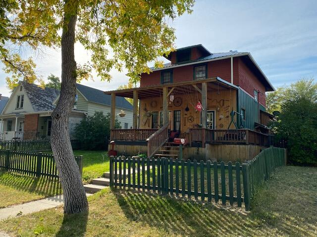 So much potential in this 4 bedroom, 2 full bath home, with original hardwood floors. New roof in 2019, and new jetted tub in the rustic basement full bath. Fenced back yard and garden area, along with extra off street parking or RV.  Sit on the large covered front porch sipping your sweet tea while enjoying this beautiful fall weather.