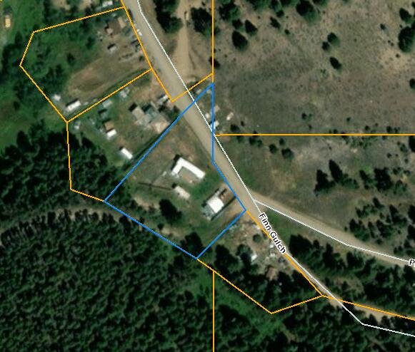 No Covenants in the little town of Wicks. Older mobile home with addition on just under 1 acre. Property has well, septic and propane gas heat. County maintains and plows road to the property.