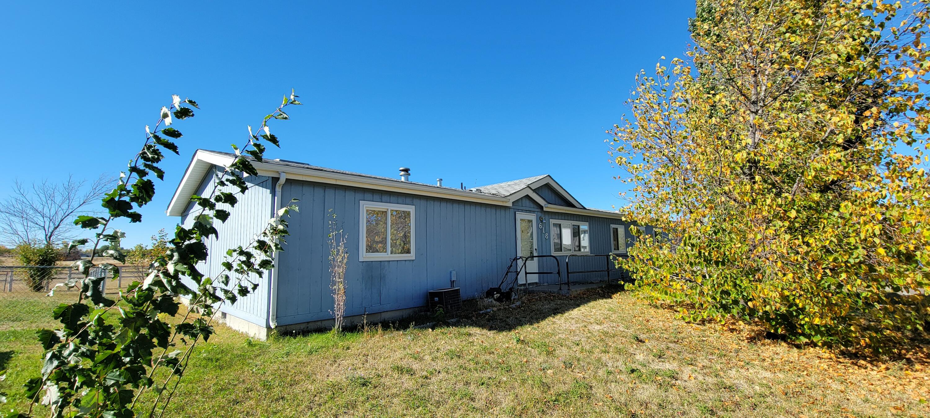 Bring this beautiful ONE LEVEL home back to its shine!  East end home close to Malmstrom Air Force Base. 1993 manufactured home on permanent foundation. Imagine enjoying Montana sunsets from your back deck. Spacious 4 bedrooms/ 2 Bath with separate living room and family room. Den could be used as office or a toy room. Need some TLC but has great potential.Property sells in ''AS IS'' condition.Listed by Dori Johnson.