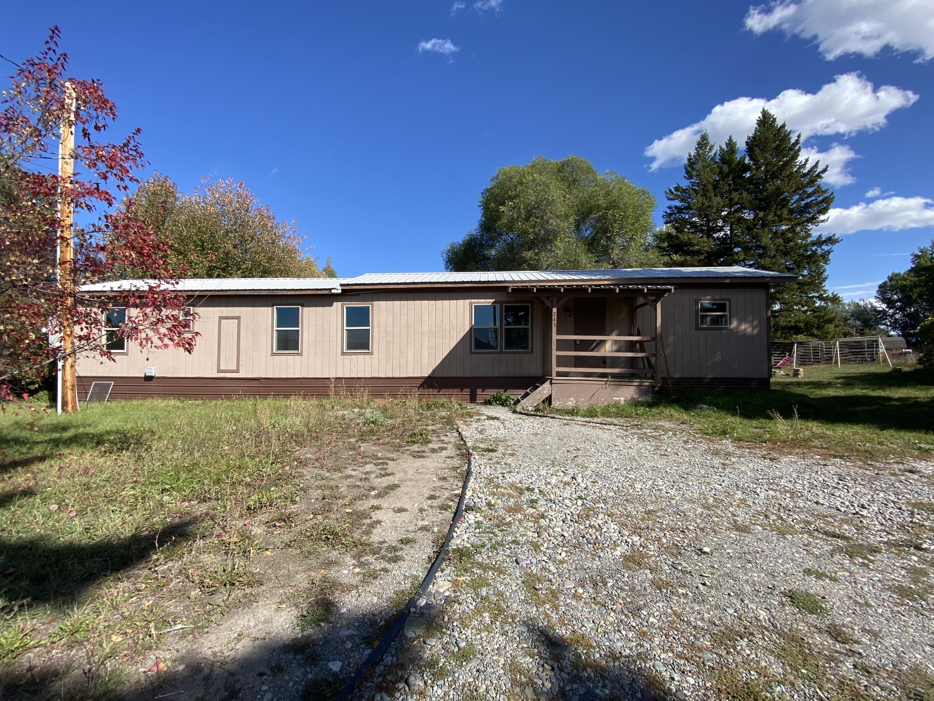 3 bedroom 1 bath single wide home on a great lot.  This home has had some updates and has a lot of potential, home being sold ''AS IS'.  Trees surrounding the lot for privacy and large yard for room to play. Contact Amy Kelly 406-261-5215 or your real estate professional to schedule a showing.