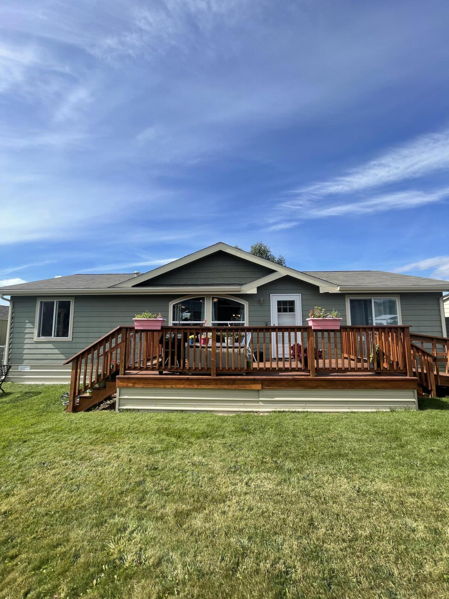 Come see this updated home in the Hellgate School District. Nicely remodeled 3 bedroom, 2 bath home is ready to move in. All new flooring and doors. Kitchen island. Newer stainless steel appliances. Master bedroom on one end and the other 2 bedrooms are on the opposite end. New water heater in 2018. Front deck ready for enjoying the evenings and weekends. Covered back deck leads out to the fenced yard, perfect for pets. Exterior features well maintained landscaping and shed. Carport protects your vehicles against the elements. Home is on a leased lot. Buyers will need to be approved by the park prior to closing. Call Deb Kees at 406-303-1308, or your real estate professional.