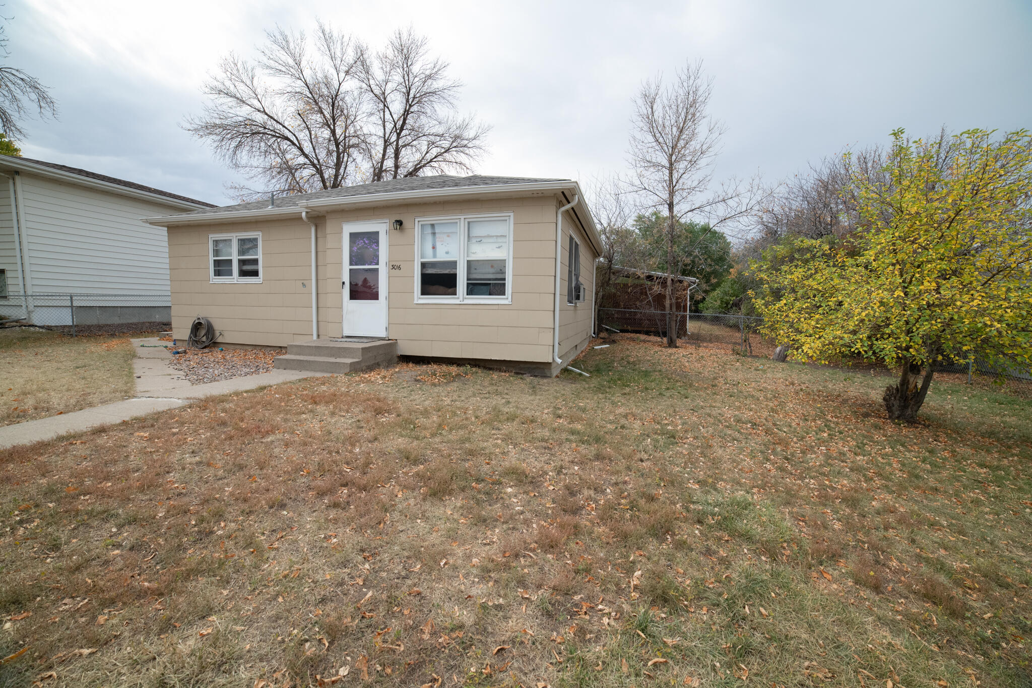 Investment opportunity! Two homes on one lot on east side of town. Front home 3016 2 Bedroom 1 bathroom fenced yard, on street parking.Back home 3018 2 bedroom 1 bathroom, fenced yard, off street parking. call your real estate professional before its gone!