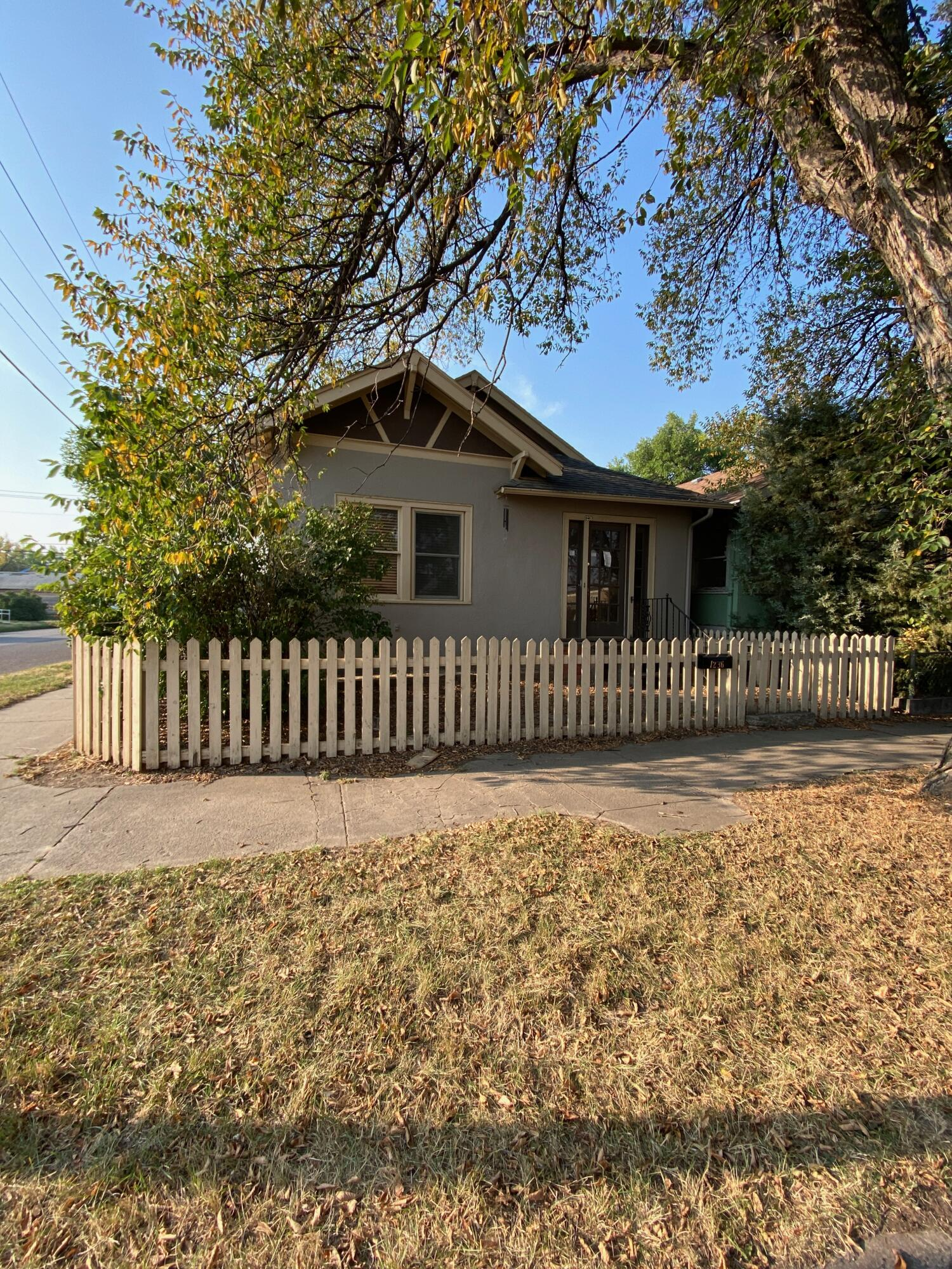 Check out this 2 bed, 1 bath home with an oversized 1 stall garage.  The main floor is mostly updated, with newer kitchen, bath, & also main floor laundry in one of the bedroom closets.Text/call John Carlson at 406-390-1381, or your real estate professional