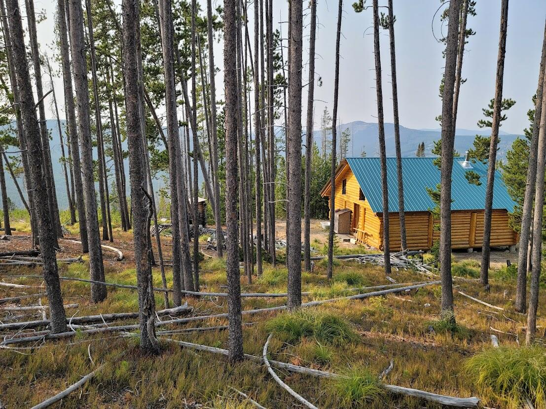 Hunting Cabin ... Summer Recreational Spot.  Look no further.  This parcel has a beautiful log cabin that boarders the Forest Service.  Wildlife is bountiful.  In the winter months there is a groomed snow mobile trail close by.  This place is ready for your recreational needs. *Snow mobile access only in the winterCall Cortney & Dan at 406-439-7557, or your real estate professional.